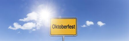 "Sign ""Oktoberfest"" in front of sky with white clouds"
