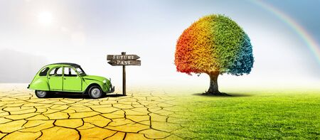 Colorful tree and old vehicle with sign Future and Past in a desert and a green meadow in climate change Фото со стока