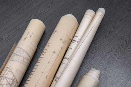 Old blueprints on black desk Stock Photo