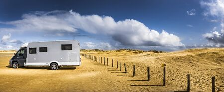 Mobile home parked on the beach Stock Photo