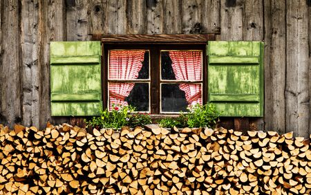 Window of an alm hut with checkered curtains