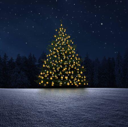 Shiny christmas tree at night in snowy landscape Standard-Bild