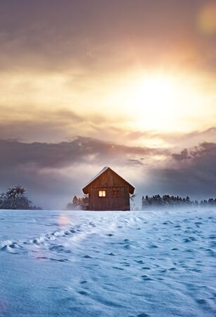 Wooden Cabin in winter holidays Stock Photo