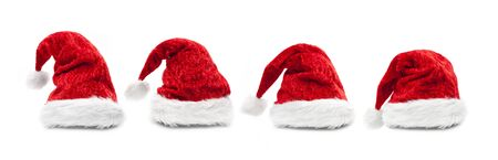 Red Santa Hats isolated o white background Imagens