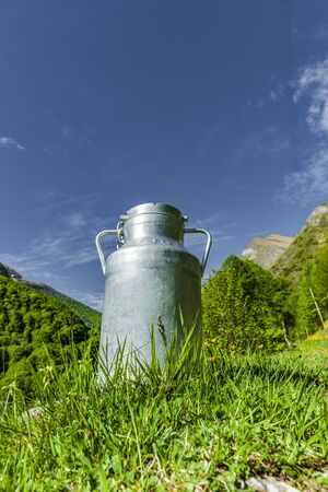 Milk can in a mountain meadow in the mountains