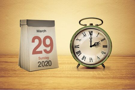 Alarm clock with time changeover to summer time and calendar with the date of Sunday 29 March 2020