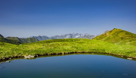 Mountain lake at Col de Tente in the Pyrenees Foto de archivo