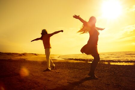 Young couple dancing on the beach Stock Photo