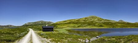 Log cabin by the lake in Rondane National Park, Norway