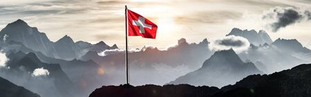 Swiss flag in front of Swiss Alps