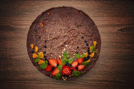 Homemade chocolate cake on dark background