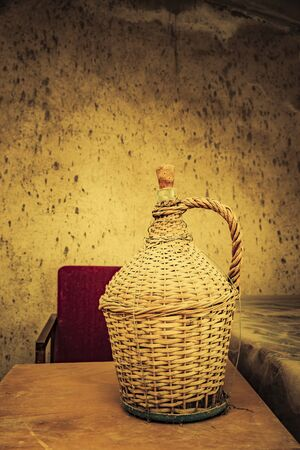 Old wicker bottle as a decoration
