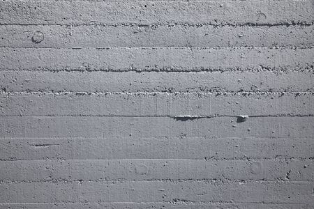 Wall made of gray exposed concrete 스톡 콘텐츠