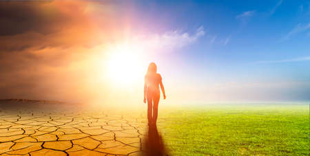Woman in a landscape with climate change Standard-Bild