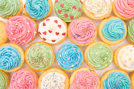 Lovingly decorated cupcakes with colorful decorations