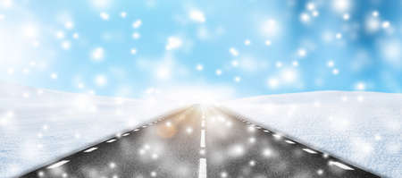 Road in winter landscape with snowflakes