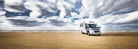 Motorhome on a sandy beach by the sea