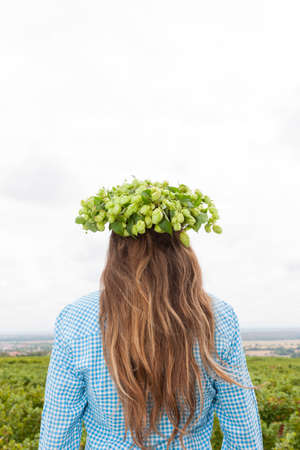Woman with a wreath of hops on her head