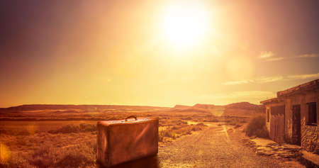 Old suitcase on a desert road