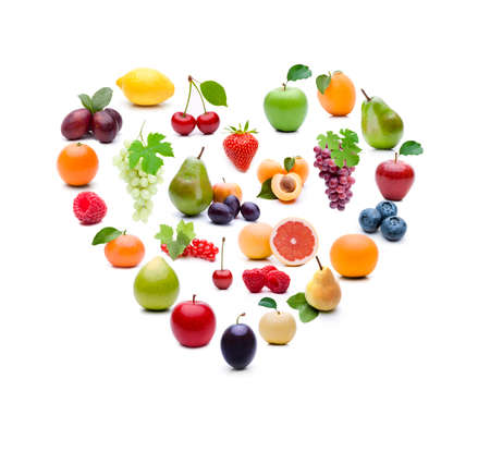 Different fruits in heart shape on white background