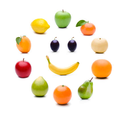 Different fruits in a circle on a white background