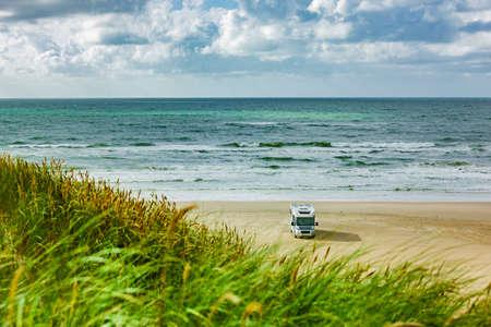 Motorhome on a sandy beach by the sea