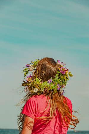 Brunette woman with wreath of flowers in Sweden