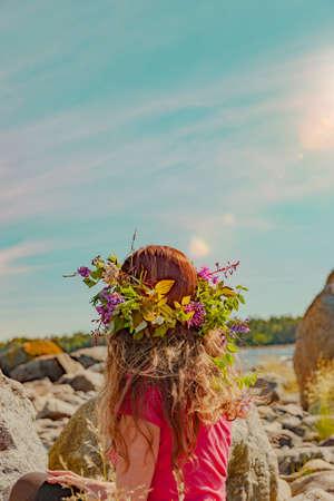 Brunette woman with wreath of flowers in Sweden Stock fotó