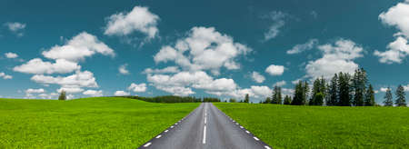 Road through green hilly landscape