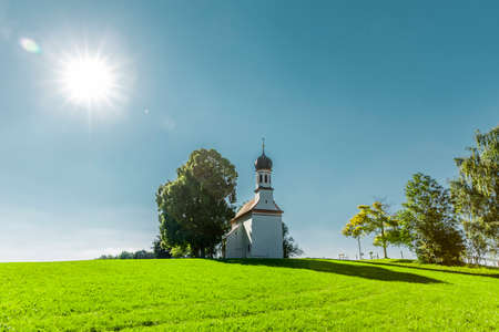 Chapel in Allgäu Landscape with sunshine