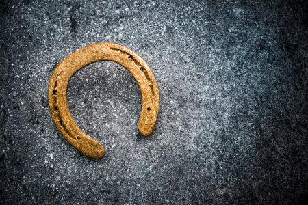 Golden horseshoe as a symbol of luck