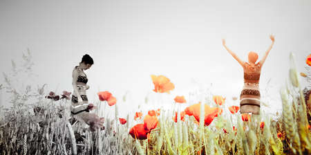 Silhouette of a woman in a poppy field with different emotions as a concept 스톡 콘텐츠