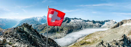 Swiss flag in front of rhone glacier