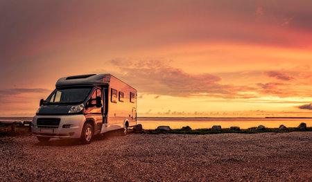 Camper van at sunset on beach