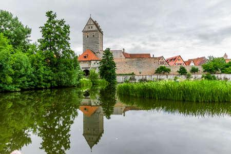 Rothenburg Gate and Dinkelsbühl pond in Bavaria