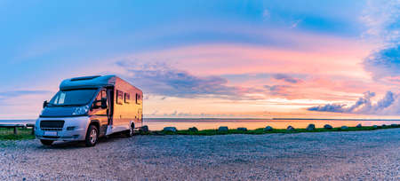 Motorhome at sunset on the beach