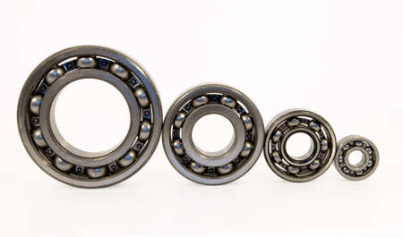 Four bearings of the different size from stainless steel photo