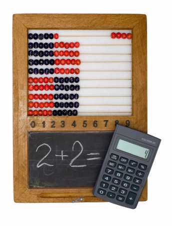 adds: Childrens school board and abacus made in the fifties last century and the modern calculator Stock Photo