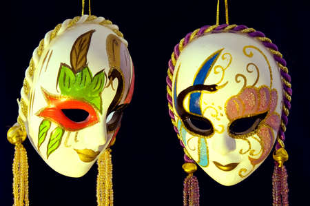 conceal: Two Venetian masks of handwork on a dark background Stock Photo
