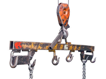 Lifting mechanism with hooks and chains on a white background photo