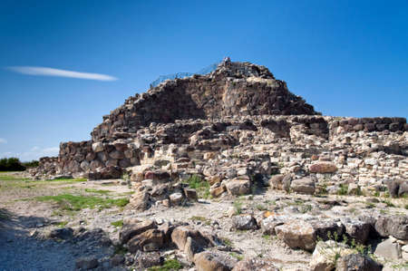 truncated: Nuraghe Su Nuraxi di Barumini - typical Bronze Age buildings called Nuraghe, the most important archaeological site of the Sardinia. It is a circular defensive towers in the form of truncated cones built of dressed stone.