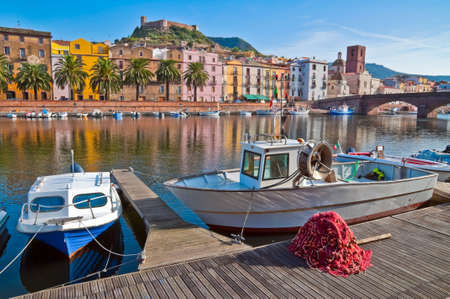 trawl: Fishing boats and nets on the river in Bosa in Sardinia