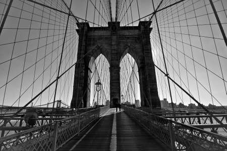 Black and white of the world famous Brooklyn Bridge walkway photo