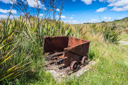 horse and cart: Old historic mine trolley from the Victorian period, abandoned and decaying, New Zealand