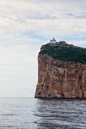apo: Lighthouse on the cliff at ?apo ?accia, Alghero, Sardinia, Italy