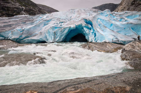 jostedalsbreen: Jostedalsbreen glacier and glacial river in Norway - melting because of Global warming. Stock Photo