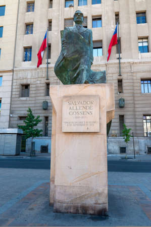 salvador allende: Santiago, Chile - December 2, 2012: Statue honoring former president Salvador Allende, who lost his life in a 1973 coup detat across the square at the La Moneda Palace.