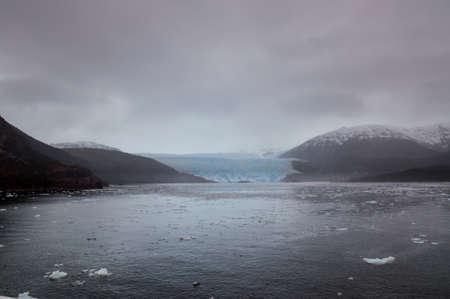nasty: Amalia Glacier on the edge of the Sarmiento Channel, Skua Glacier, Bernardo OHiggins National Park, Chile - in overcast rainy weather, nasty day