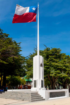 plaza de armas: Punta Arenas, Chile - December 9, 2012: Chilean flag against blue sky in Plaza de Armas, Punta Arenas, Magallanes Region, Chile.
