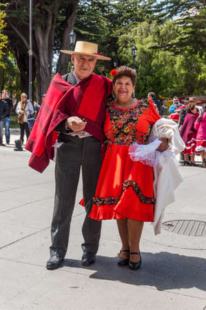 punta arenas: Punta Arenas, Chile - December 9, 2012: The chilean man and woman In chilean clothing during the meeting of the Folk dance club of Punta Arenas, Chile.